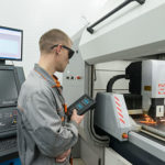 worker watching production of electronic components in factory manufacturing skills gap