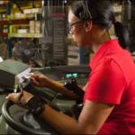 woman working in warehouse using forklift mounted printer manufacturing productivity