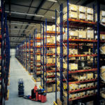 large warehouse filled with boxes and inventory. Real-time Data visibility tracking technology can't help.
